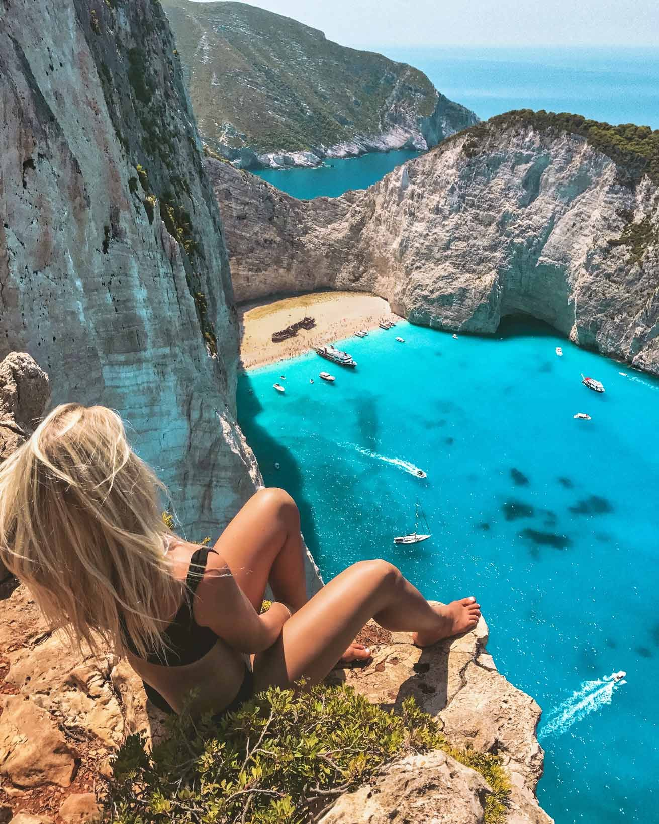 Navagio Aka Shipwreck Beach Is The Most Photographed Scene In All Of Greece And Truly Epitomizes The Beauty Beautiful Places To Travel Beach Visiting Greece
