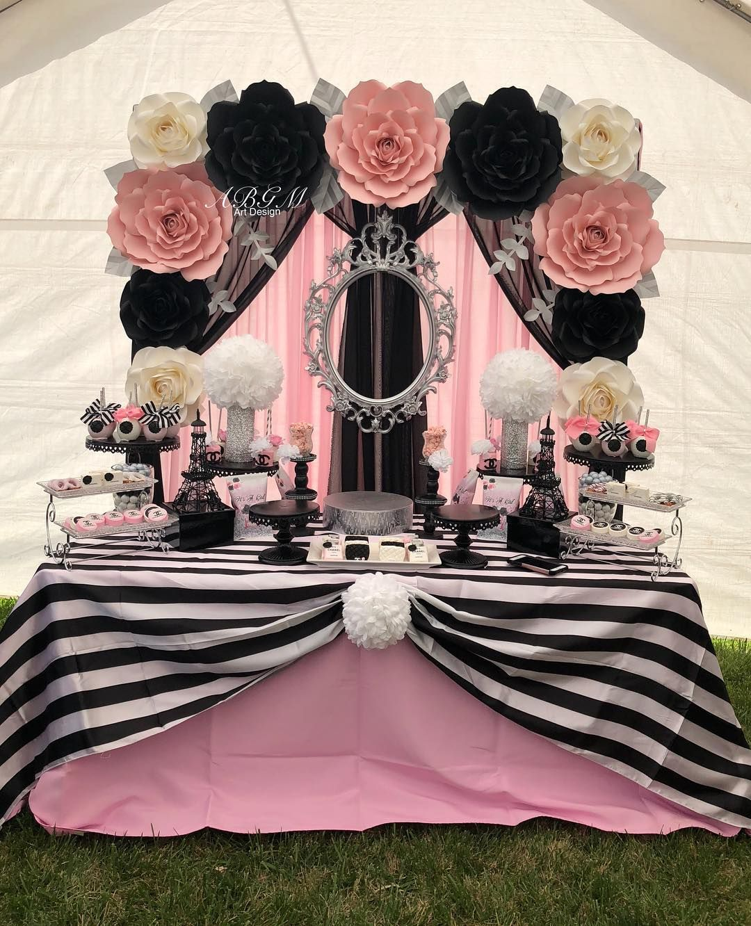 Paper flower backdrop in colors white pink black and silver used