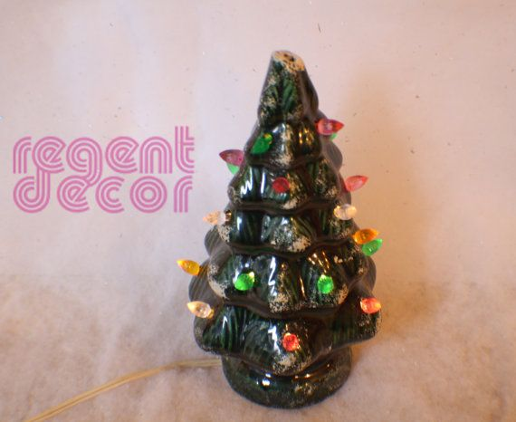 A vintage ceramic Christmas tree that comes with its original box. The top star snapped off but could be easily replaced. The tree still lights up