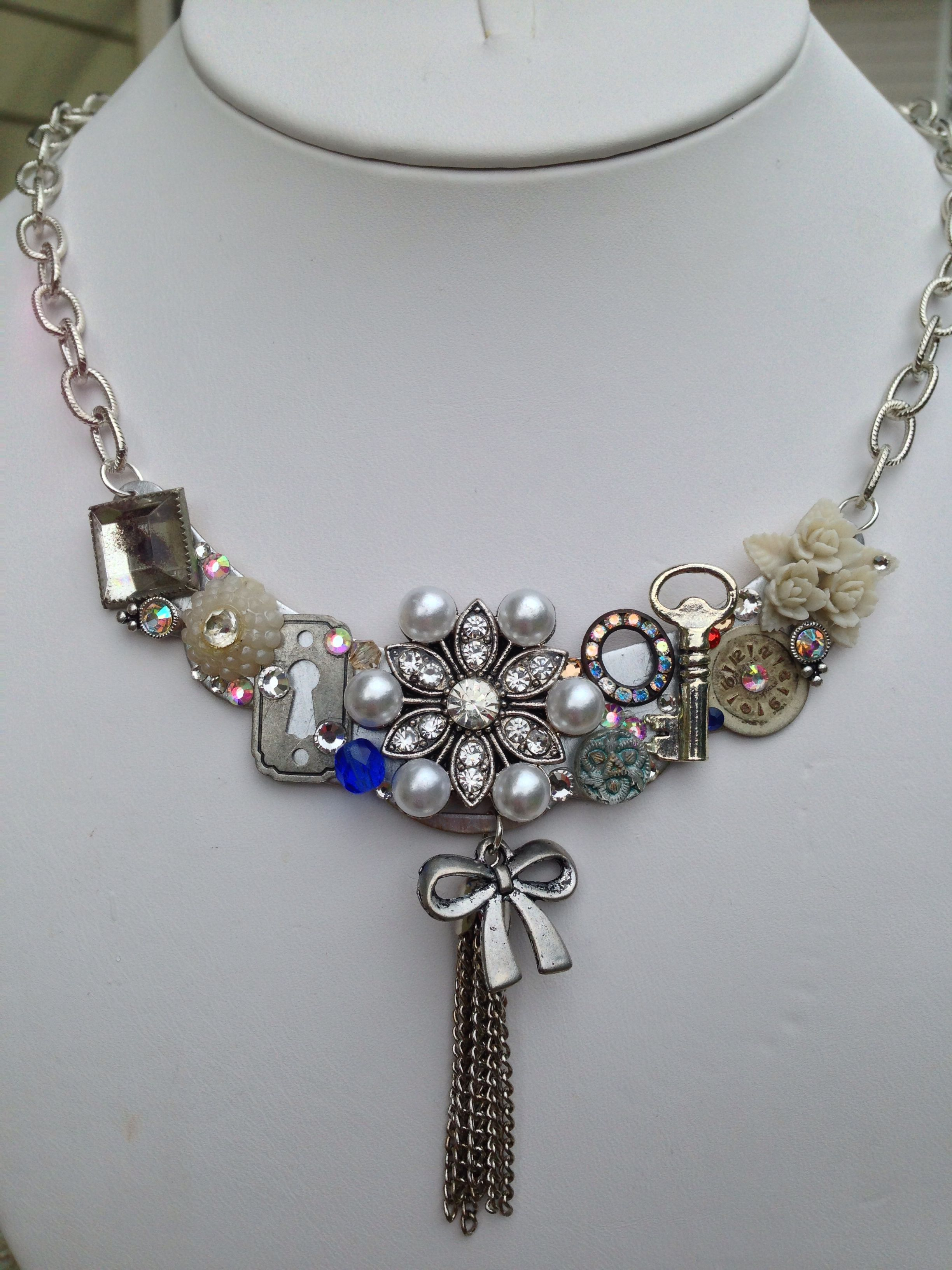 Silver base metal collage necklace made with vintage buttons and bits, charms and crystals by Wylene at Shady Lane Jewelry. $50 shadylanejewelry@yahoo.com