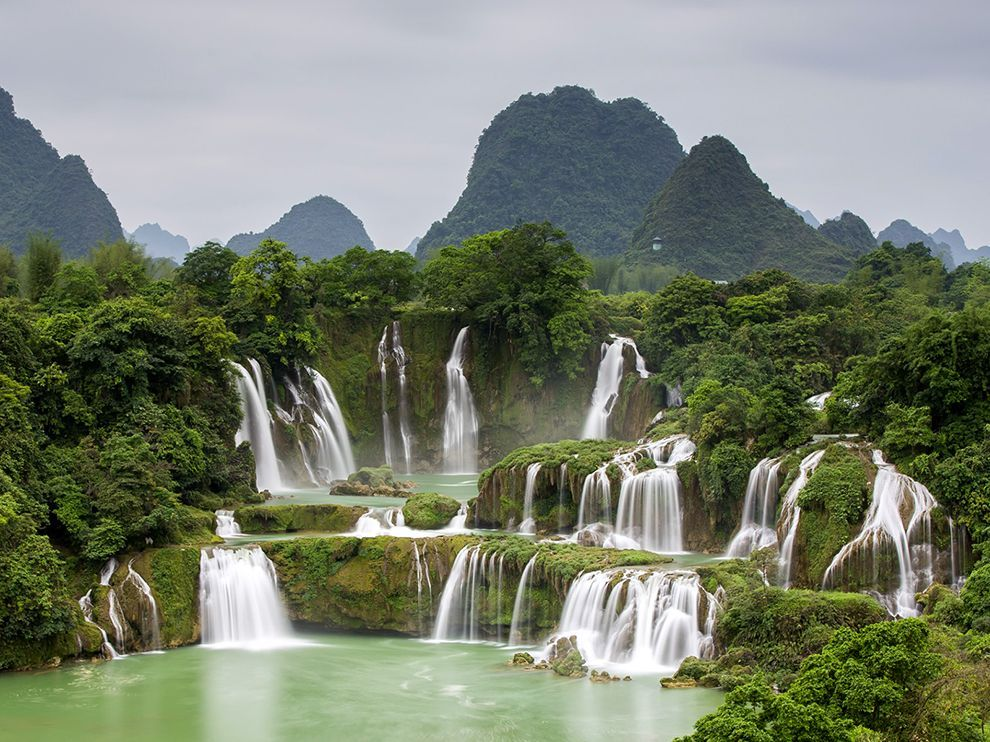 Ban Gioc waterfall in the far northern Vietnamese province of Cao Bang is one of the most popular sites in the region, which boasts a famed karst landscape of striking limestone peaks. The falls thunder into Vietnam from China, churning up an ever present mist. Photograph by Son Tong, June 17, 2014