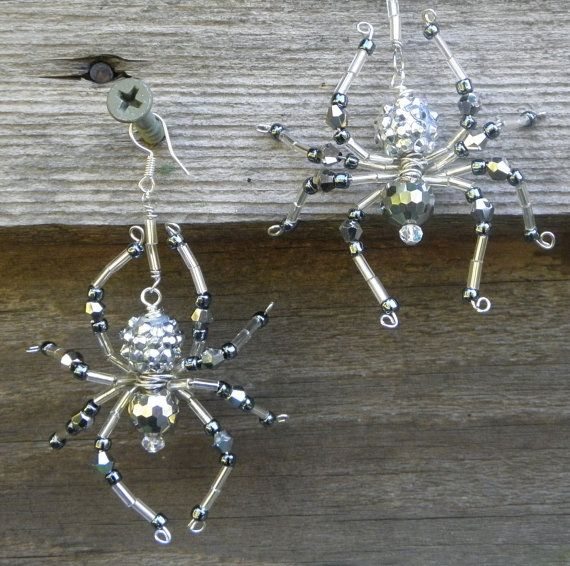 Beaded spider earrings made with crystals and seed beads. Earrings measure approx. 3 from top of hook to bottom of leg.