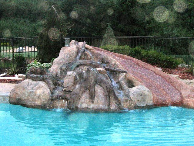 Carved Concrete Water Slide And Rocks Swimming Pools Backyard Swimming Pool House Stock Tank Pool