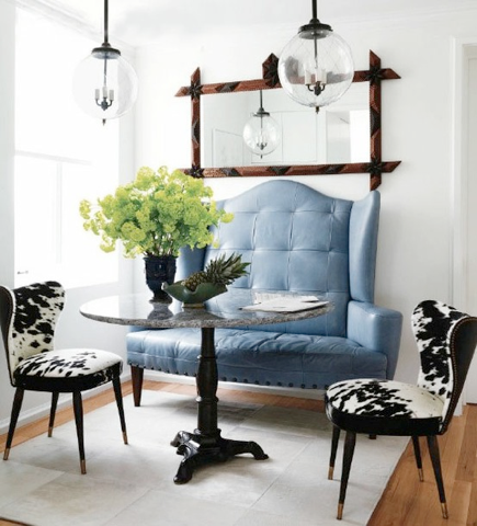 Vintage Blue Tufted Loveseat And Cow Hide Dining Chairs