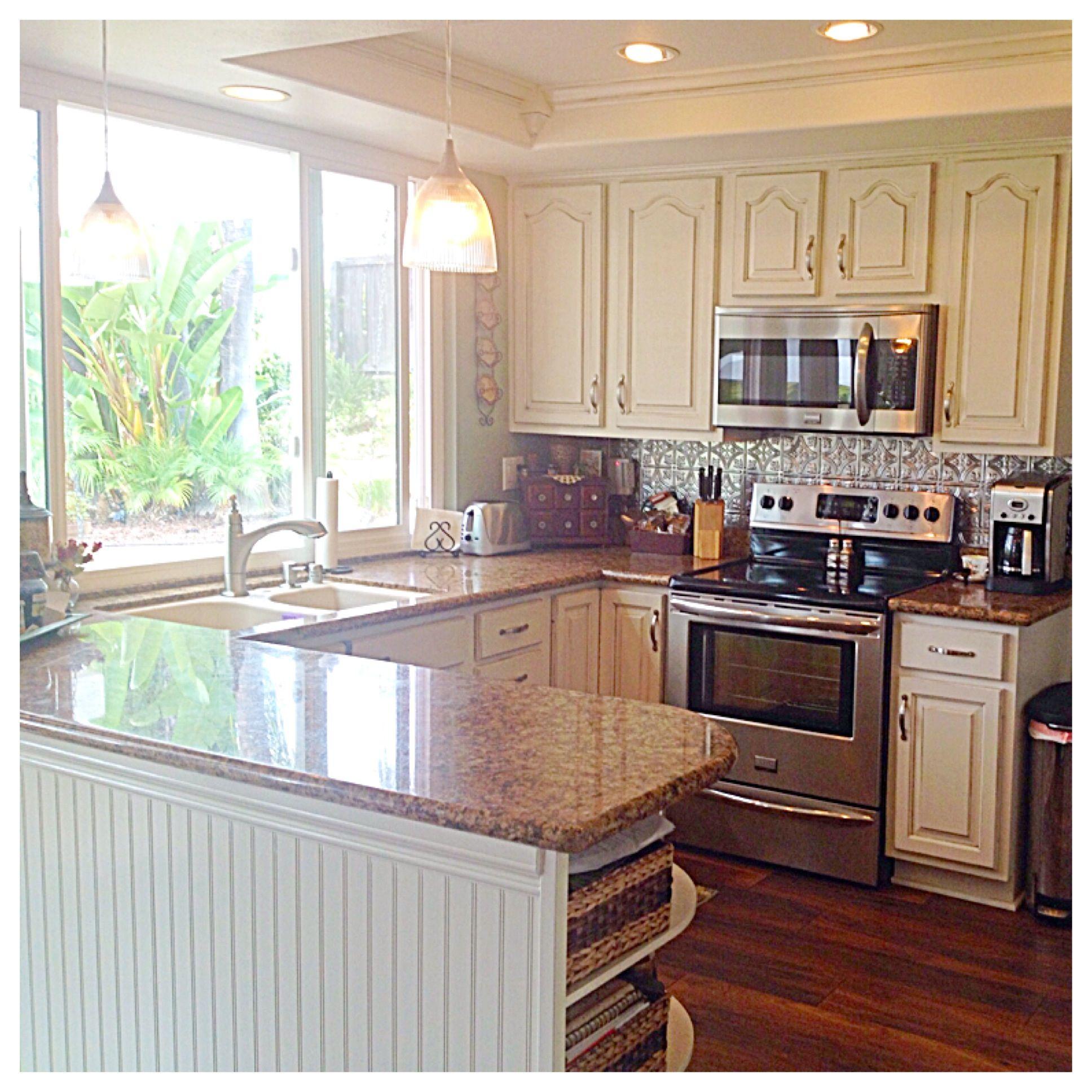 Kitchen DIY remodel. Oak cabinets painted antique white ...