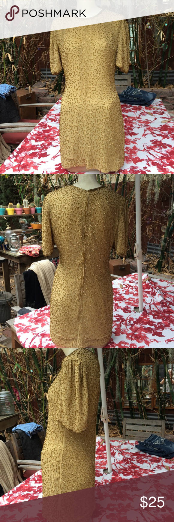 Vintage beaded 100% pure silk mini dress or tunic Vintage beaded 100% pure silk mini dress or tunic just beautiful. Size PS. Made in India loved and used. Designed by Lawrence Kazan. The ham has been repaired as gently as possible Lawrence Kazar Dresses Mini