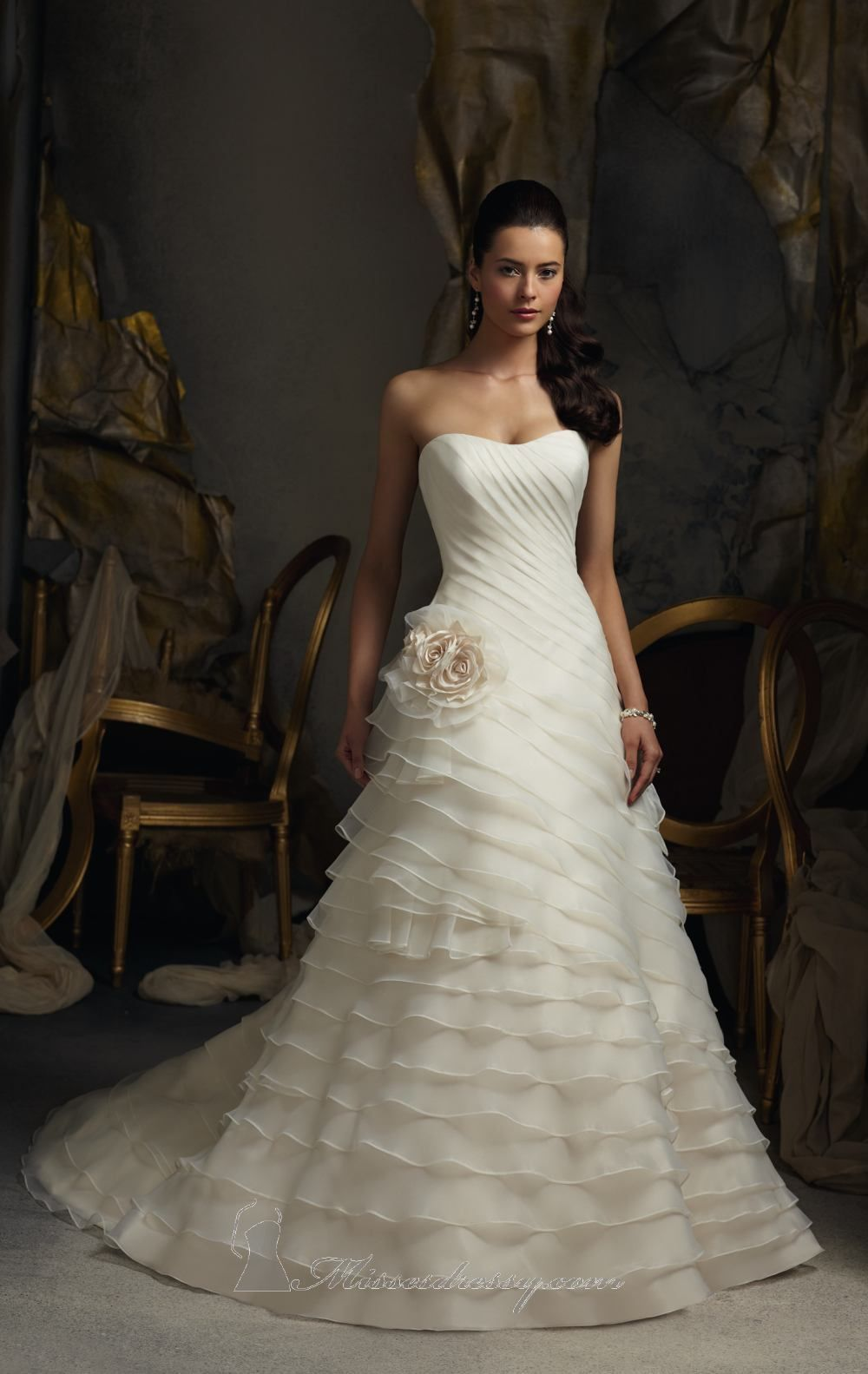 You'll be a fabulous bride in this Blu by Mori Lee 5105 wedding gown. This low back strapless gown is organza which is asymmetrically tiered...