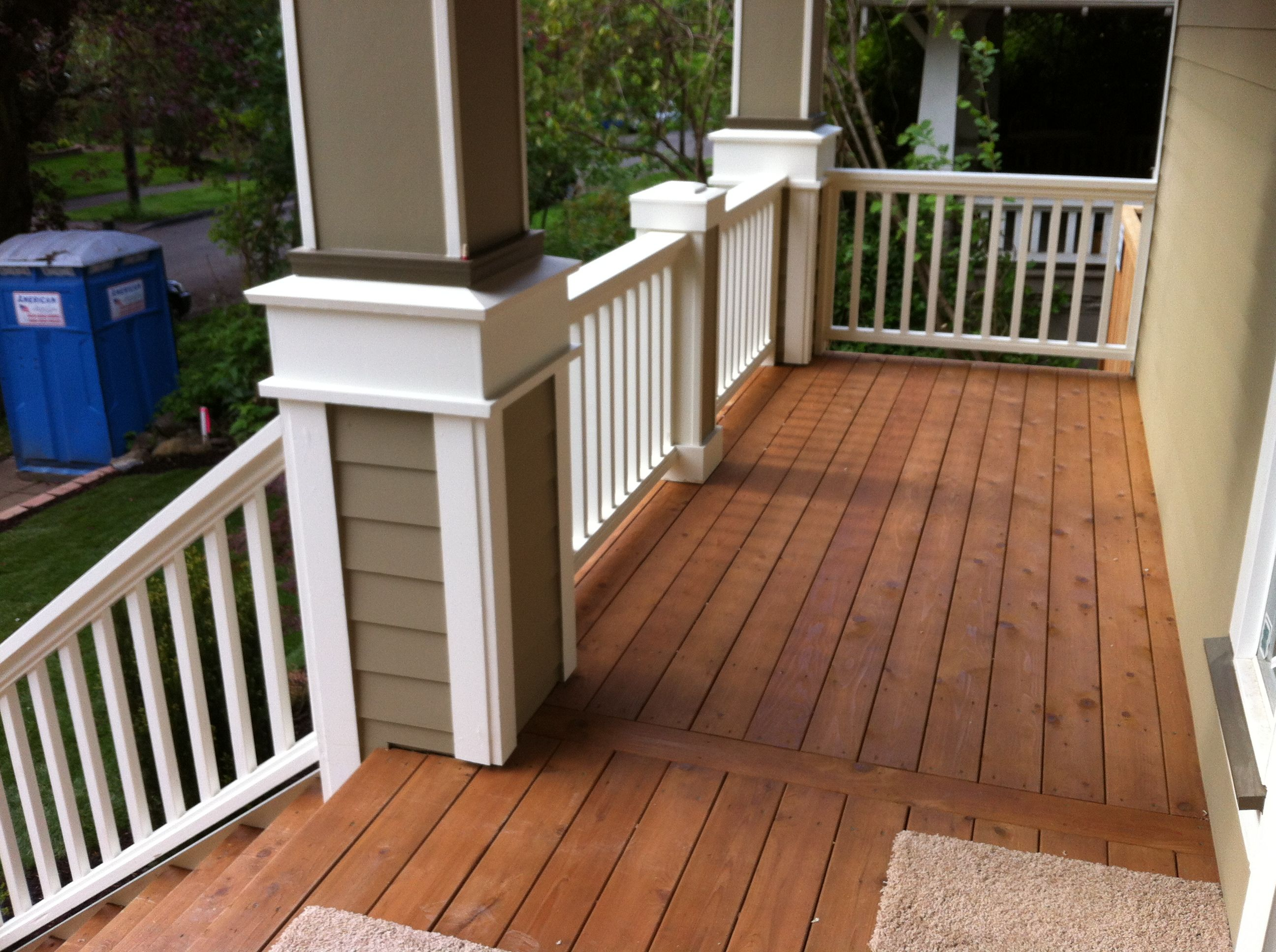 Stained cedar decking with wood railing idea for the for Outside decking material