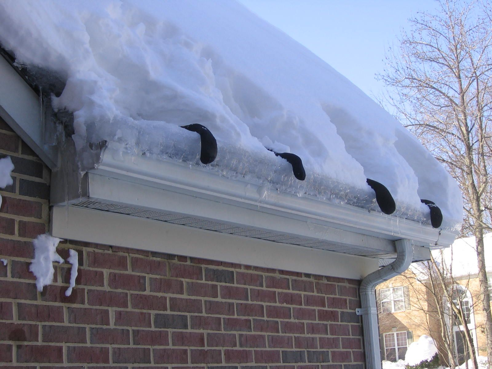 salt socks in action helping to prevent ice dams | winter