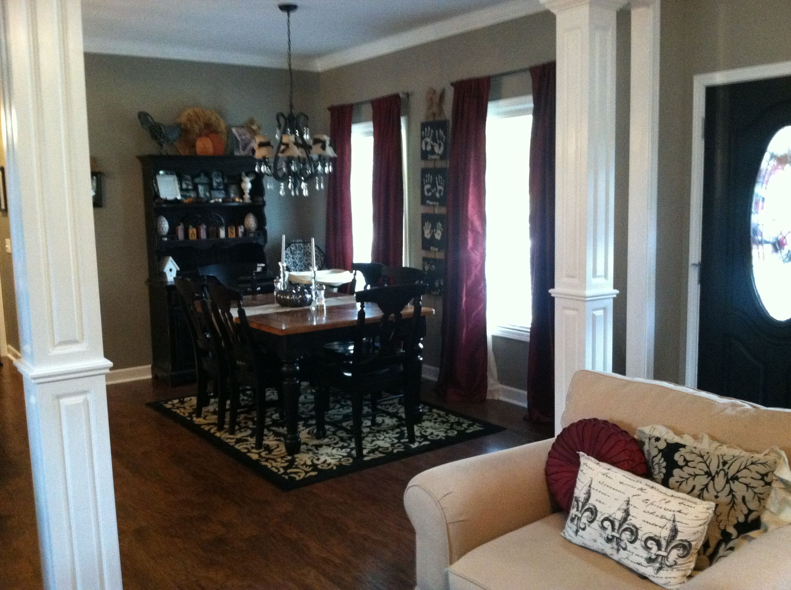 wood columns living room dining room kitchen black tan damask rug