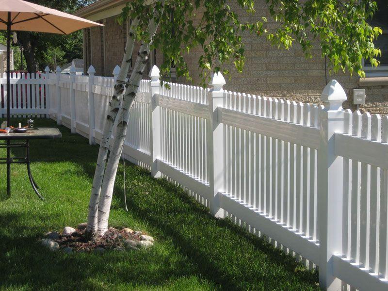 pretty white vinyl fences make your yard look even bigger
