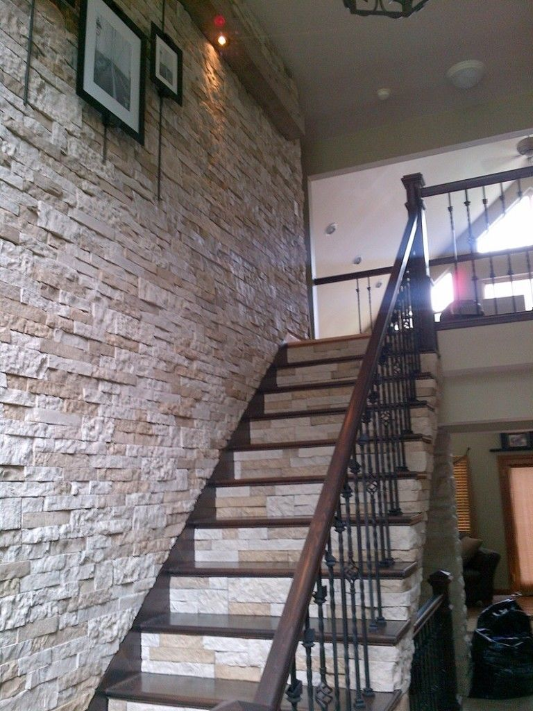 airstone, for that dramatic wall of stone going up the staircase