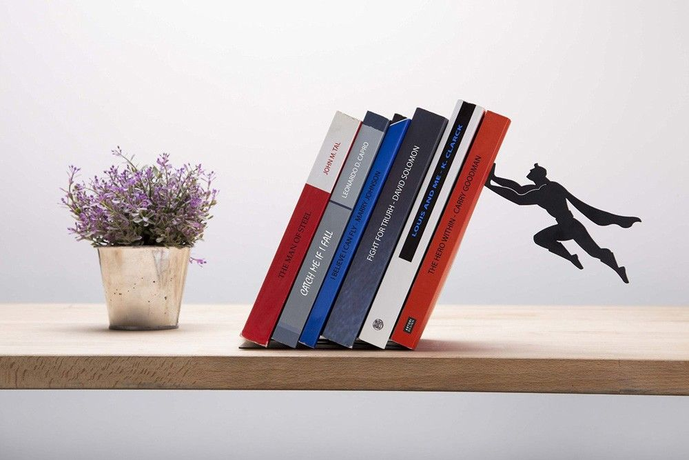 Invisible Floating Bookshelf Held By A Literary Superhero Is Amazing