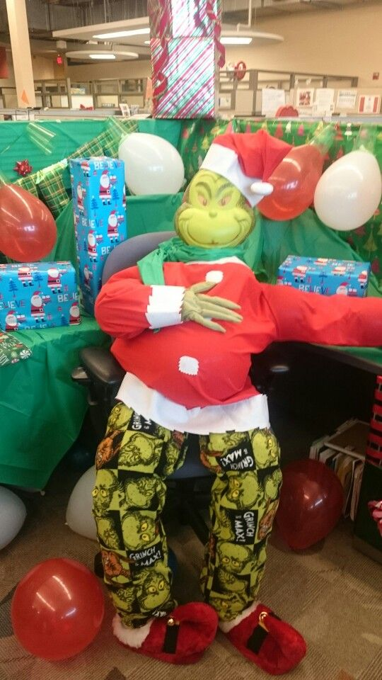 Bought The Grinch costume and hands from Party City, pants from Meijers, and shoes from CVS. Stuffed with small balloons and paper to keep it light and easy to move.