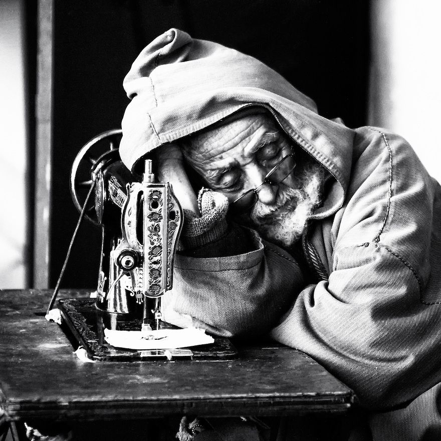 Old man sleeping near his sewing machine. Fine Art black ...