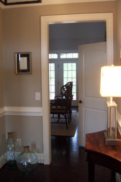 Kdmac: neutral  recycled glass jars, chair rail and warm gray walls paint color.