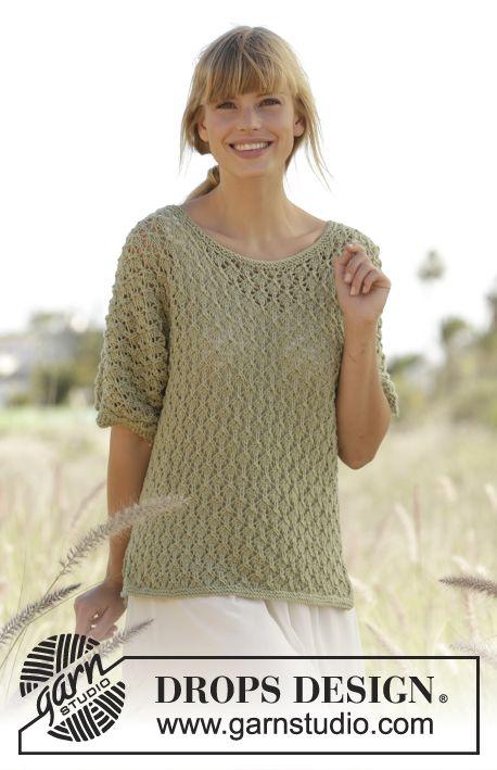 ca870b0b3c5 Mariela   DROPS Extra 0-1261 - DROPS pulovr – halenka s krajkovým vzorem a  krátkým rukávem pletená z příze Merino Extra Fine. Velikost  S-XXXL.