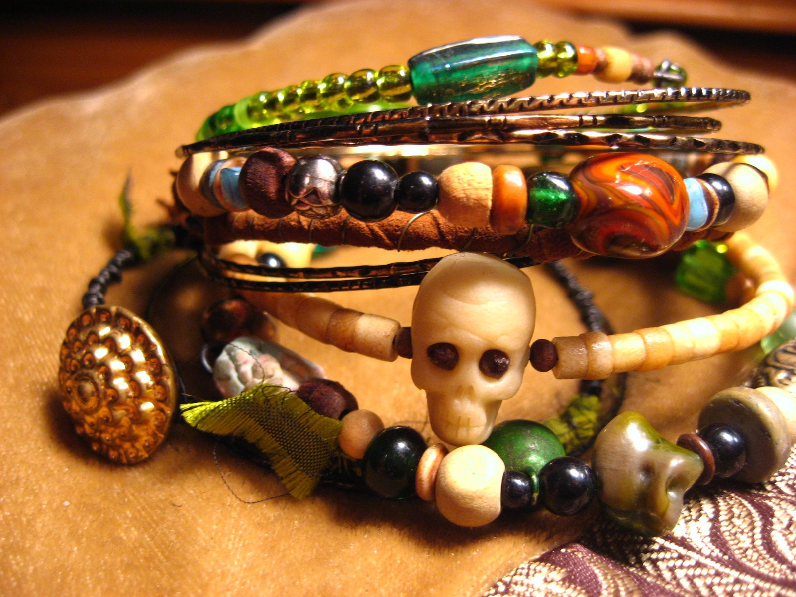 gypsy bangle stacks with bone, wood and assorted vintage glass beads, handmade glow-in-the-dark skull, other colors available $55--please inquire via https://www.etsy.com/shop/gypsypalace7
