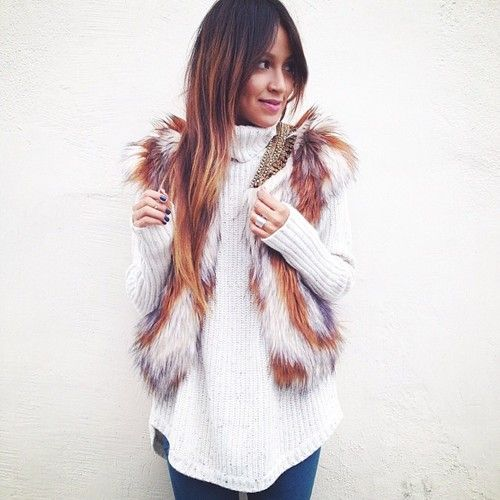 Love the turtle neck and fur vest. Very chic! #fashion