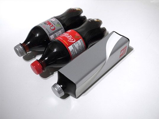 Designer Andrew Kim has created a new Eco Coke concept bottle that minimizes the packaging's environmental footprint while maximizing its efficiency. The square bottles are more collapsible, fit tightly with other bottles for efficient shipping and stocking, and are made from sugar based bioplastic.