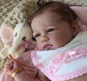 A Romie Baby Full Bodied Solid Silicone Doll Sculpted