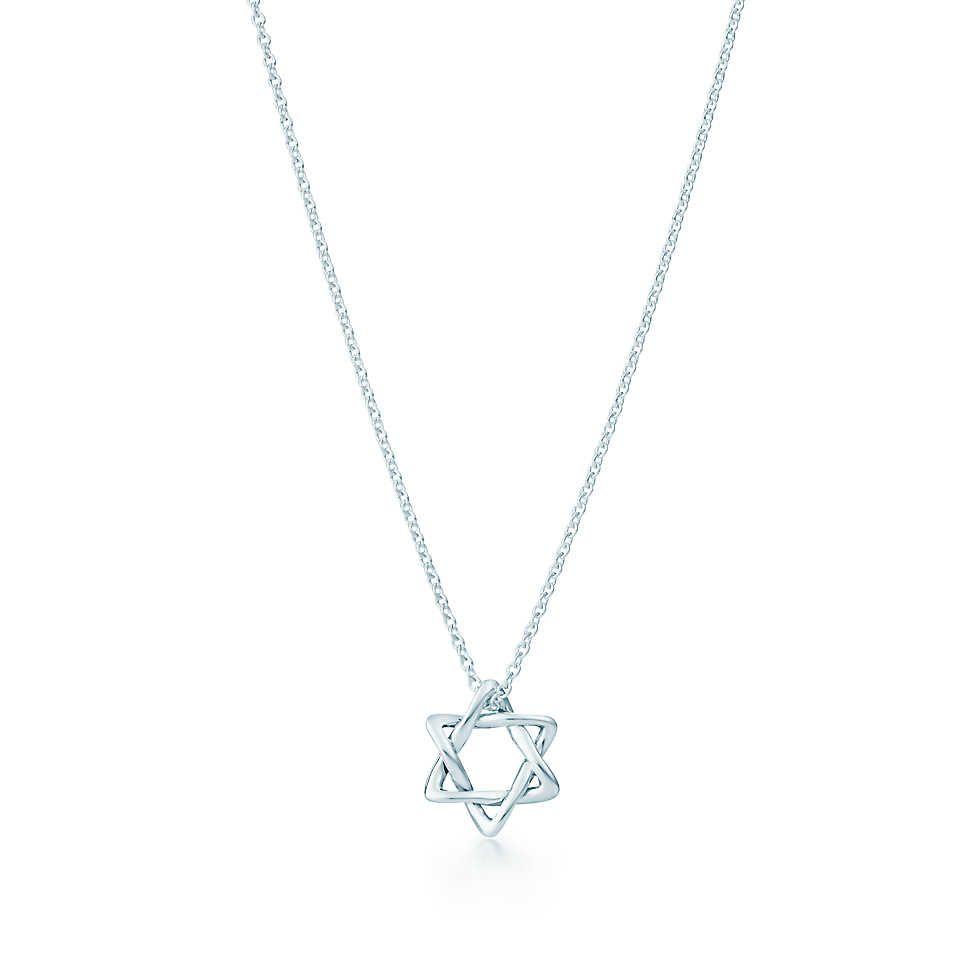 Elsa Peretti® Star of David pendant in sterling silver, 12 mm wide. | Tiffany & Co.
