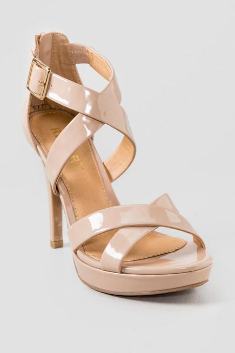 5b5c7cd93c4 This nude patent heel has a criss cross straps and adjustable ankle strap  as well as a back zip. The Report Shoes