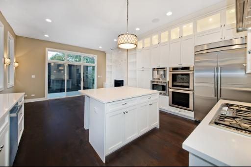Not a huge fan of white cabinets, but really love the wall of appliances--double ovens, microwave and fridge. Would have paneled the fridge, though.