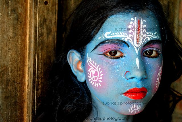 my little krishna    Her real name is laxmi.She is a lady but she is in disguise of LORD KRISHNA.This is a part of HINDU RITUAL GAJAN.Like laxmi there are many childrens who took the disguise of different gods and acted like that on the day of MAKAR SANKRANTI to collect alms.