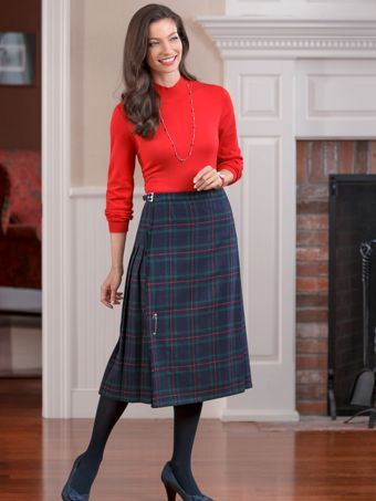 s kilt in black or plaid gives a nod