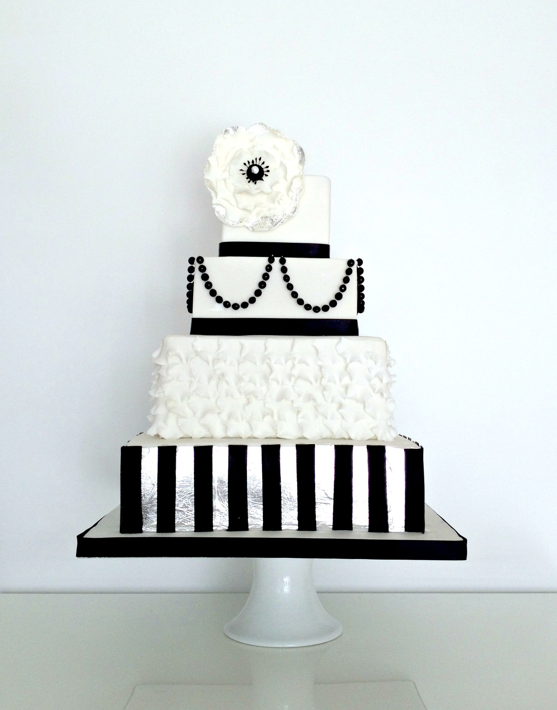 Monochrome black white and silver themed wedding cake with edible ...