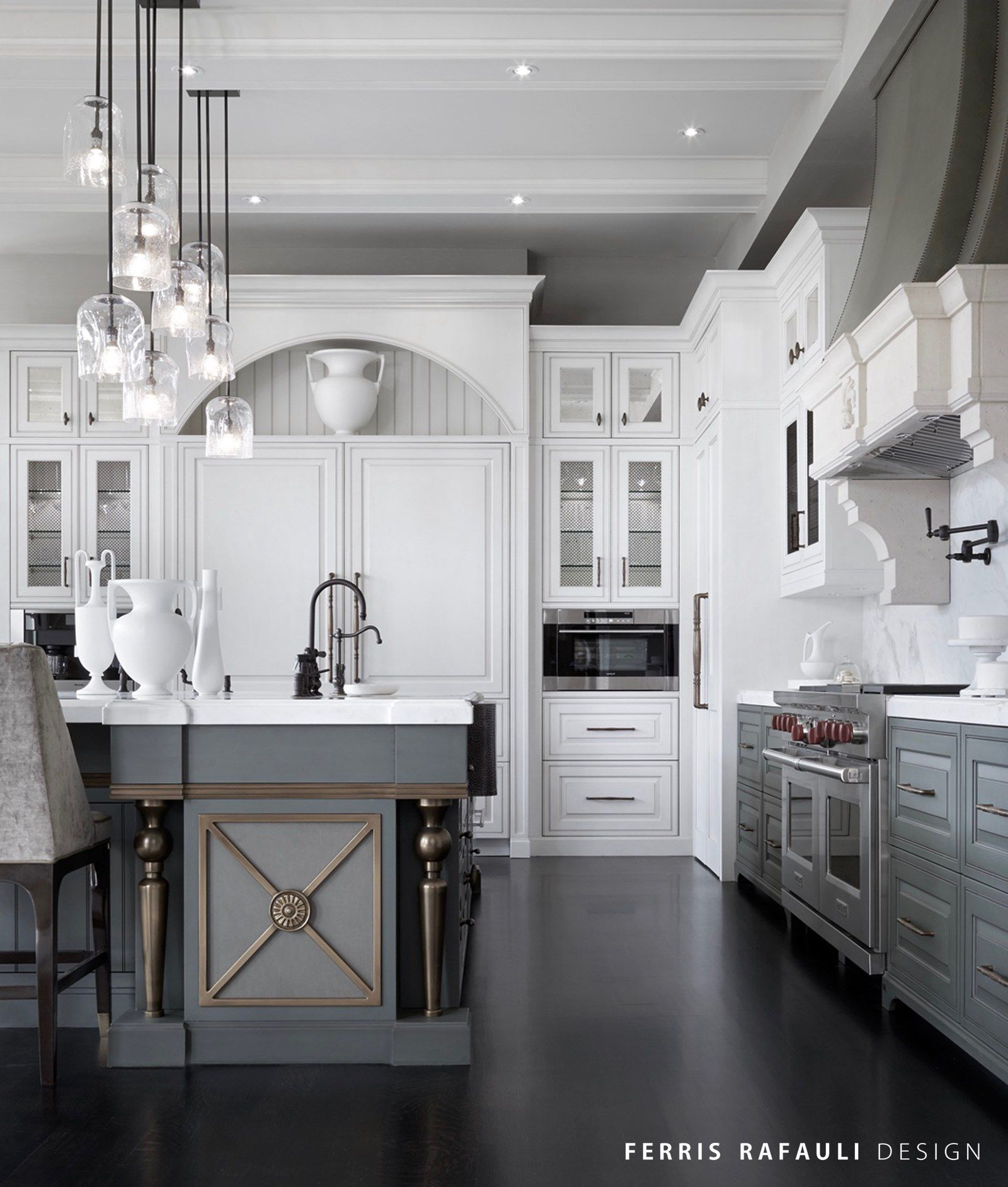 Beautiful White And Gray Kitchen Features White Upper Cabinets And Gray Lower  Cabinets Paired With Honed White Marble Countertops And A White Marble Slab  Backsplash.