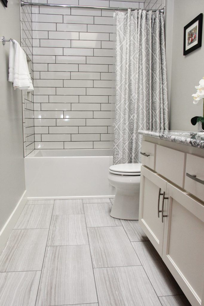 White And Grey Tiled Bathroom Floor And White And Grey Tiled Shower With Dark Grout Budget Bathroom Remodel Gray Tile Bathroom Floor Vinyl Flooring Bathroom