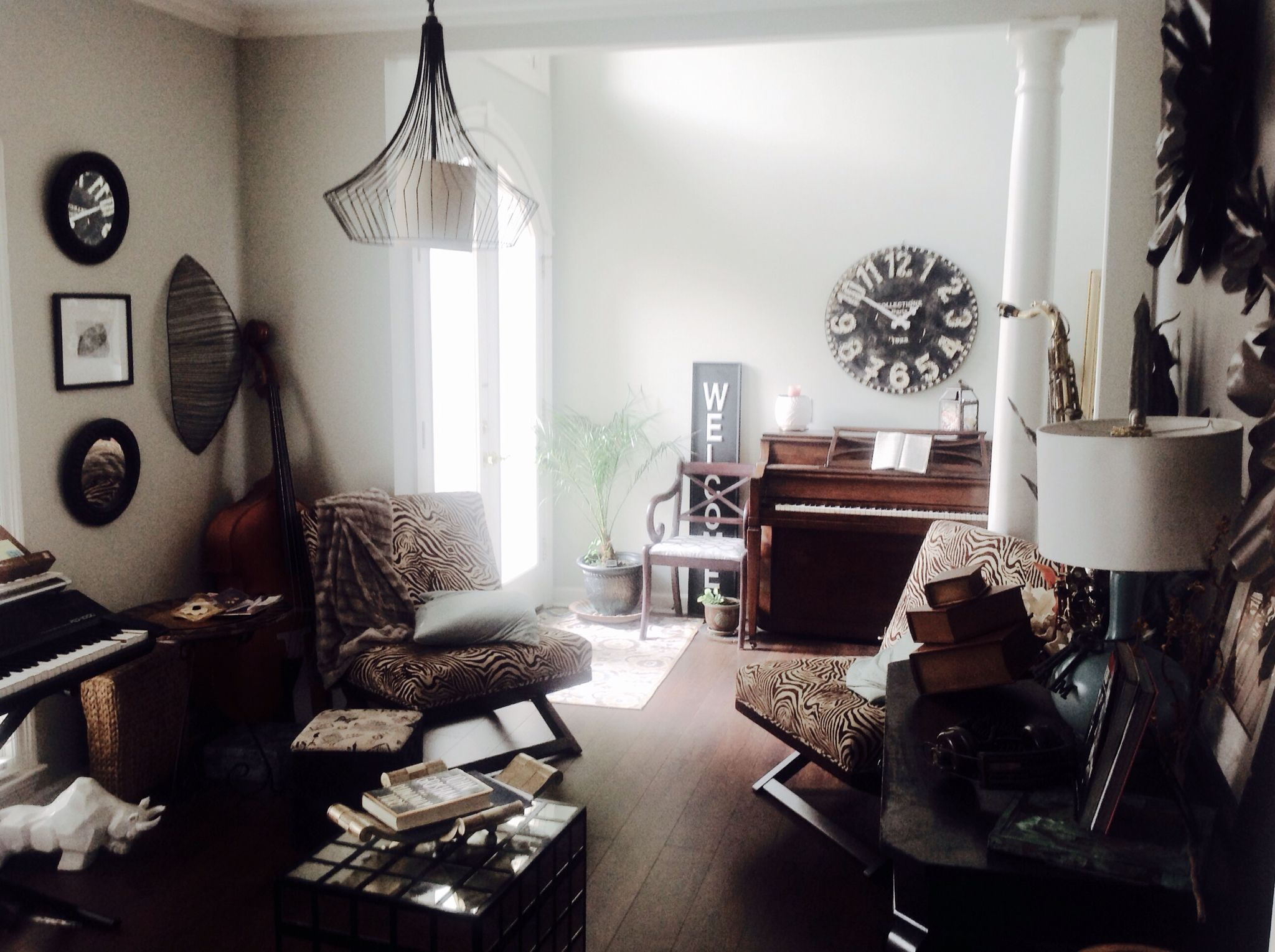 Musician\'s home. Zebra print chairs a must. Checkerboard mirrored ...