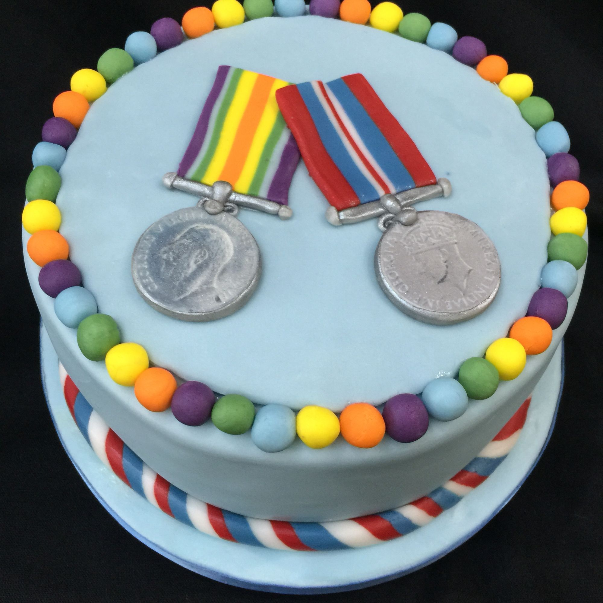Light Fruit Cake With Fondant Decoration Of War Medals For