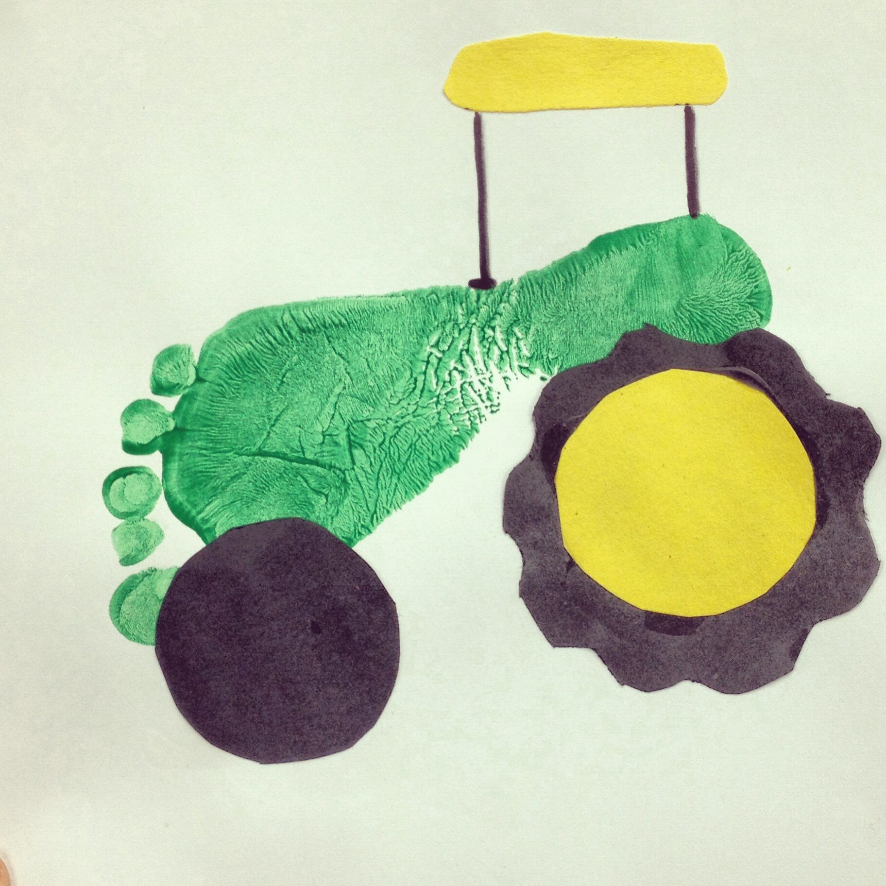 cute footprint green tractor craft for kids on the farm