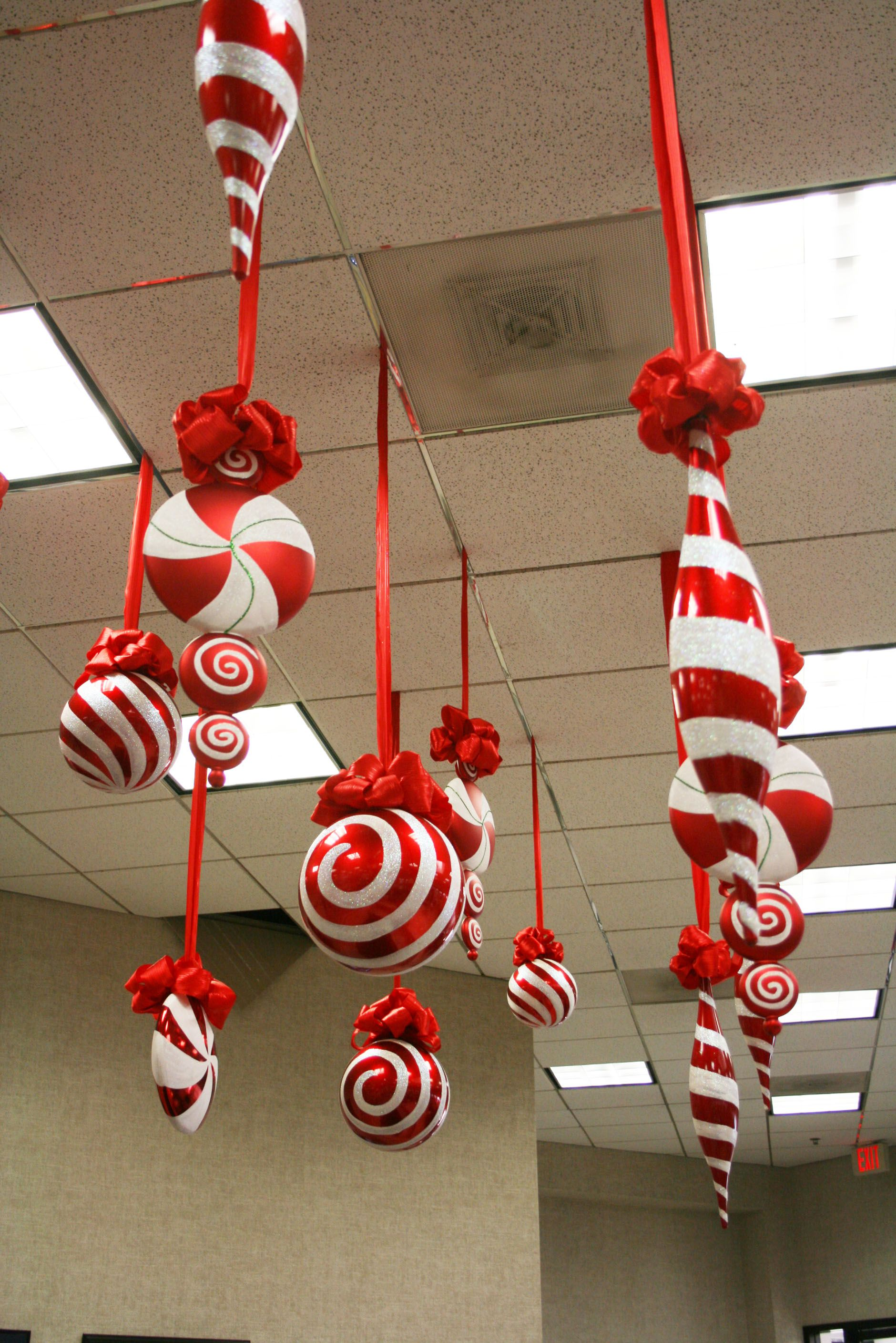 Large candy christmas ornaments hanging from the ceiling for Outdoor hanging ornaments