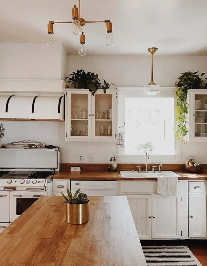white boho kitchen with oak work tops green plants porcelain sink home home kitchens on kitchen ideas white id=87098