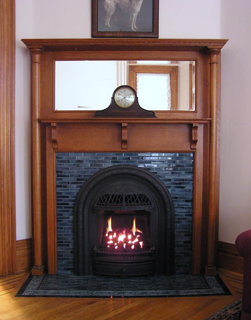 "Valor 530ICN ""Coal Fire"" Radiant Gas Fireplace and Insert. Installed with Windsor Arch with Tiled Surround in Antique Mantel. To learn more visit: www.valorfireplaces.com"