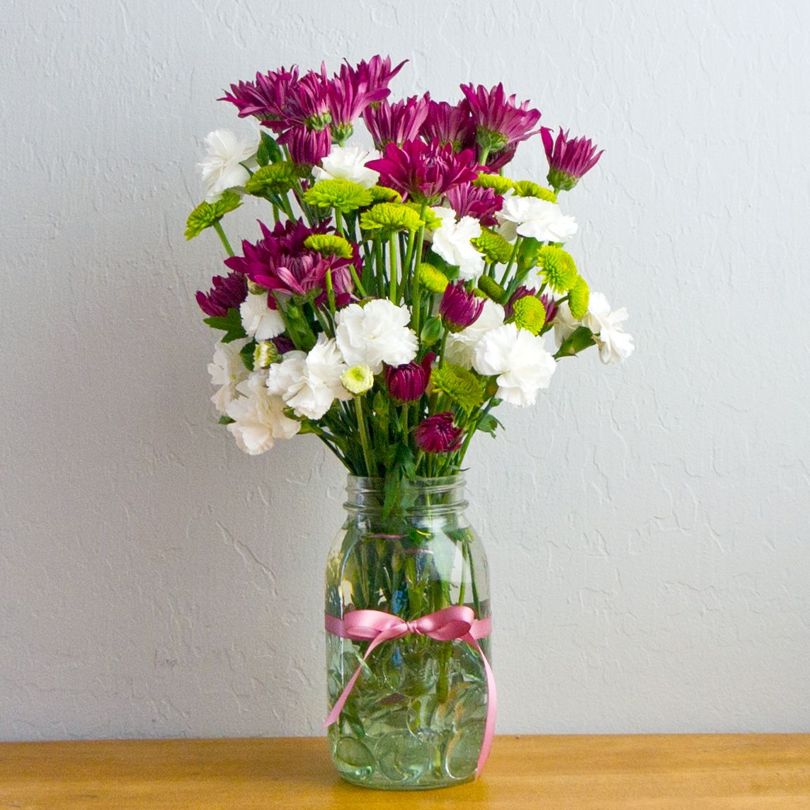 Transform flowers from the pharmacy into a stunning arrangement