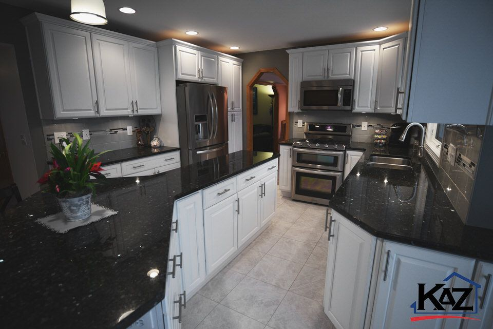 Kitchen By The Kaz Companies In Buffalo Ny Haas Cabinets Estate Style Maple White Countertop Is Emerald Pearl Granite Kitchen Remodel Kitchen Cabinet