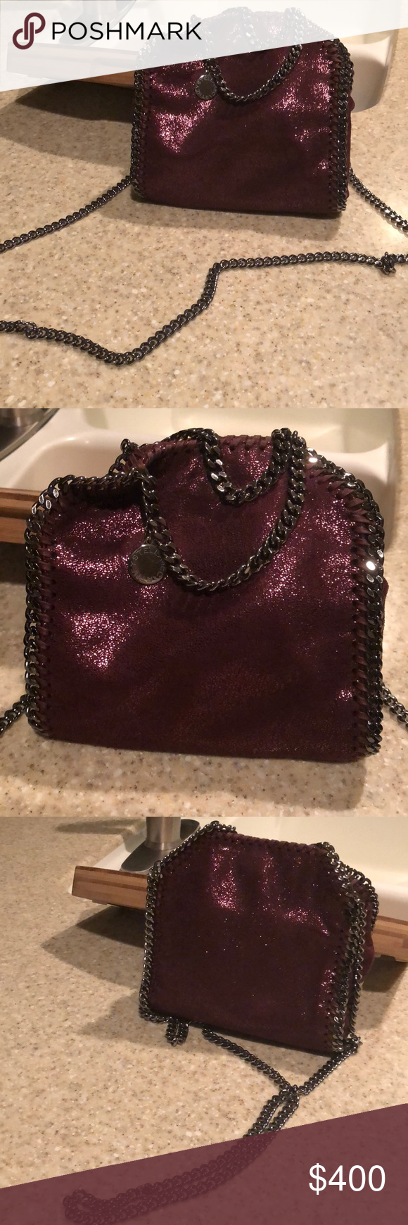 Stella McCartney Mini Falabella Crossbody Bag Used barely ever! Too tiny for my liking. Maroon metallic with silver/charcoal hardware. No flaws or signs of use. I don't have the receipt or dustbags, etc. I absolutely love this bag, but I carry a million things with me everyday and this is not the right bag for me!!!! Inside slit pocket for smallish items as well :) I believe the color is called plum Stella McCartney Bags Crossbody Bags
