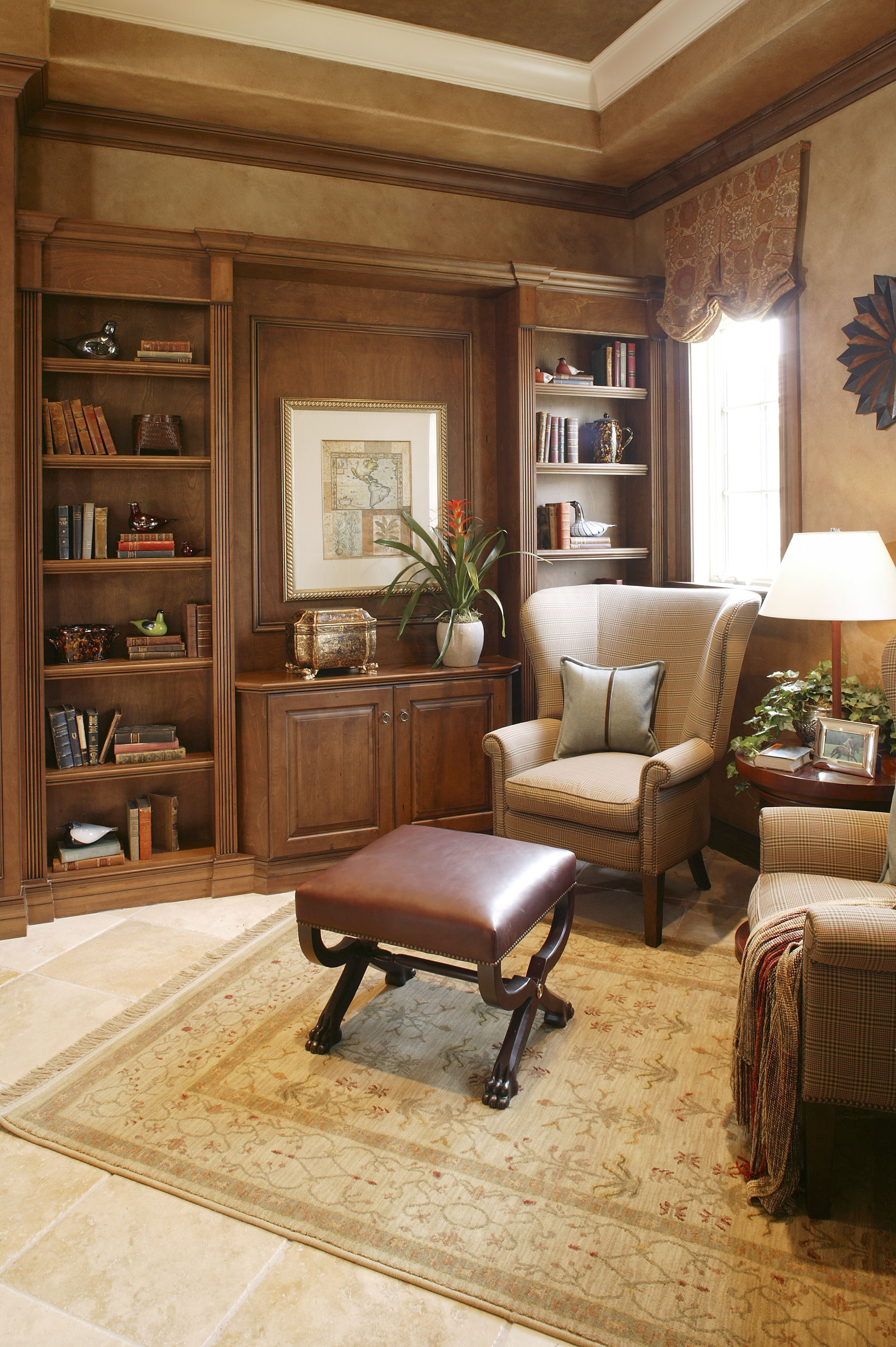 A Luxurious Work Space With Custom Cabinetry And A Built In Bookshelf.  There Is