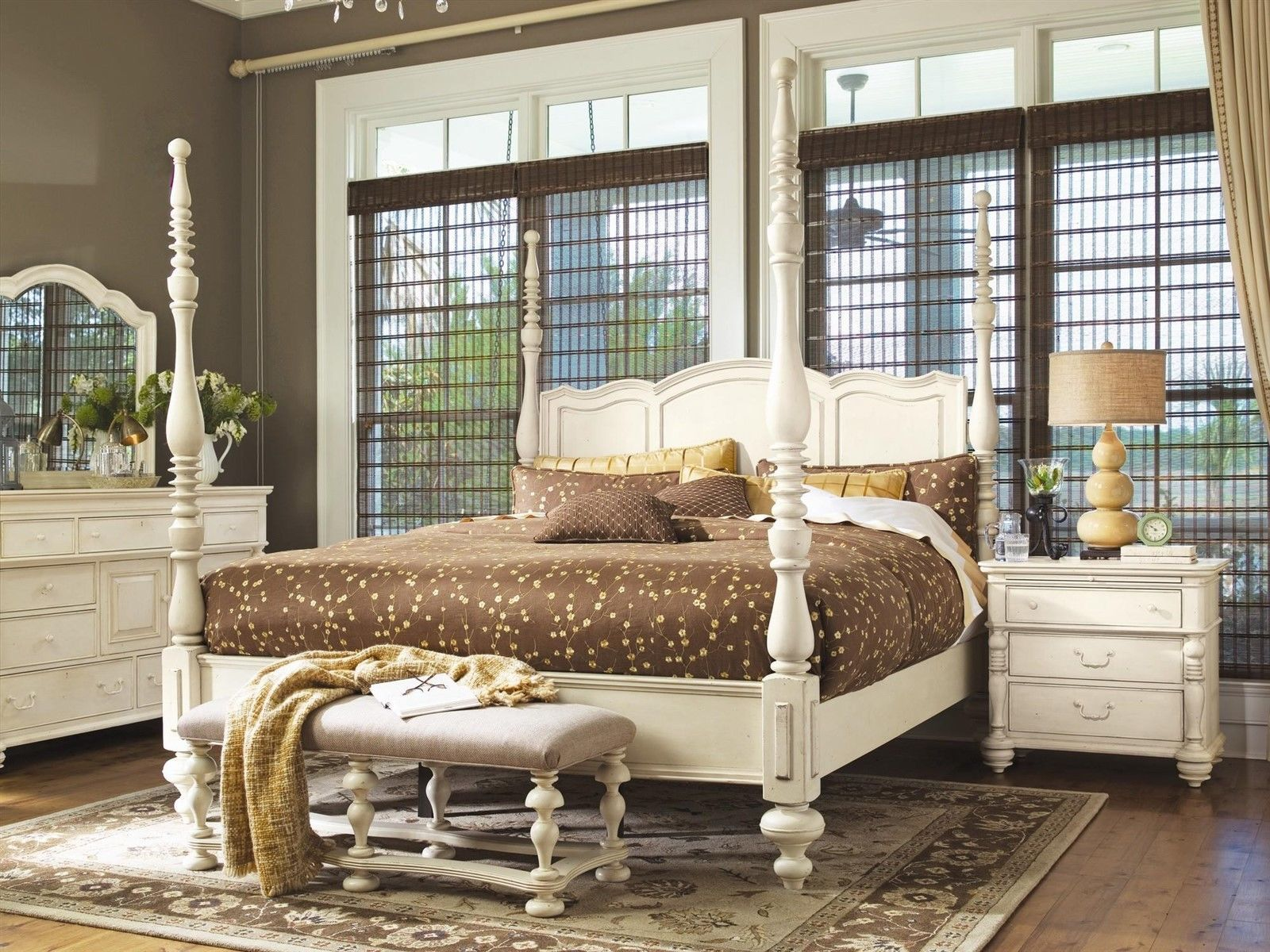This stylish white four poster bed features a French