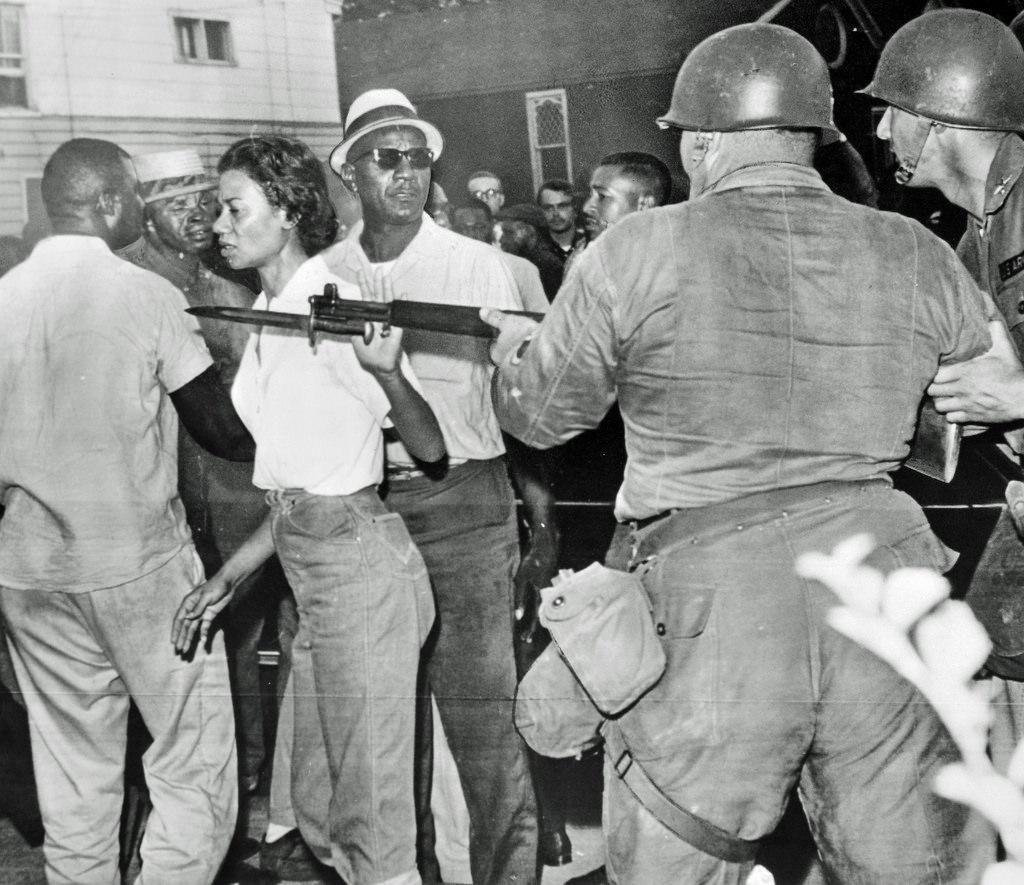 Gloria Richardson brushes off a National Guardsman at a