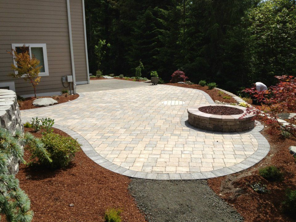 Roman Cobblestone patio with firepit. Photo provided by ...