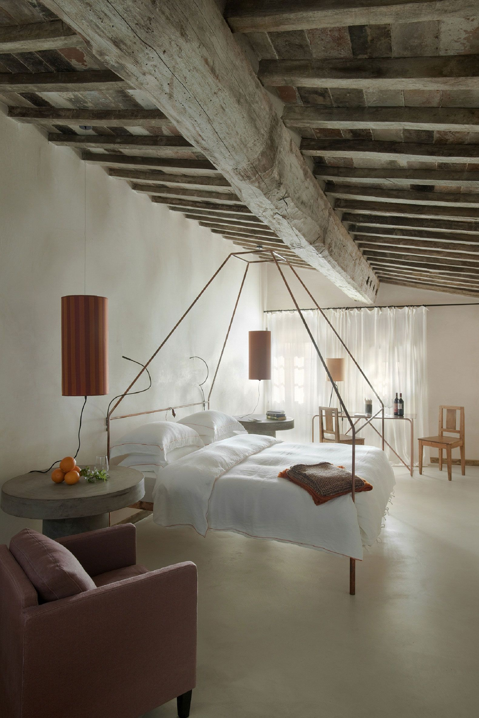 "Monteverdi is a retreat located in Castiglioncello del Trinoro, Italy, and was designed by Ilaria Miani. The structure is surrounded by the stunning Tuscan countryside, and its interior makes use of the rustic element of the exposed ceiling beams and stone walls to add character. Monteverdi by Ilaria Miani: ""Nestled in the historic heart of the Val d'Orcia region and lying dormant for the past few decades, the village of.."