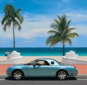 Turquoise Thunderbird convertible cruising scenic A1A in Fort Lauderdale along the white wave wall promenade. The top should be down.  http://sunny.org/beaches