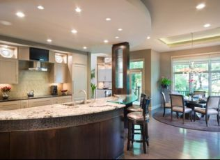 Beautiful custom kitchen with amazing island and light and dark cabinets by CHC Creative Remodeling