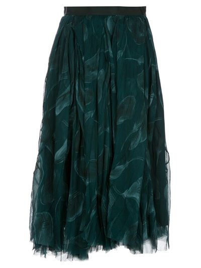 Green silk skirt from Nina Ricci featuring an elasticated waistband with a rear zip fastening, a leafy print design at the front of the skirt, a contrasting dark green panel at the rear, the piece is longer at the front.
